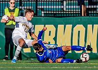 26 October 2019: University of Vermont Catamount Defender Ívar Örn Árnason, a Senior from Akureyri, Iceland, attempts to get the ball away from University of Massachusetts Lowell River Hawk Forward Stanley Alves, a Graduate from Minas Gerais, Brazil, in second half action at Virtue Field in Burlington, Vermont. The Catamounts rallied to defeat the River Hawks 2-1, propelling the Cats to the America East Division 1 conference playoffs. Mandatory Credit: Ed Wolfstein Photo *** RAW (NEF) Image File Available ***
