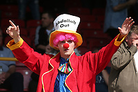 An Oldham fan dressed as a clown with 'Abdallah Out' hat protests during Leyton Orient vs Oldham Athletic, Sky Bet EFL League 2 Football at The Breyer Group Stadium on 11th September 2021