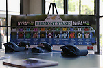 June 20, 2020: Nike hats promoting the horse Sole Volante, owned by the Reeves's, are places in front of a Belmont Stakes poster at a watch party on Saturday afternoon. Gabriella Audi/Eclipse Sportswire/CSM