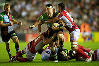 George Robson of Harlequins is tackled by Paulica Ion (left) and Daniel Browne of London Welsh during the Aviva Premiership match between Harlequins and London Welsh at the Twickenham Stoop on Friday 7th September 2012 (Photo by Rob Munro)