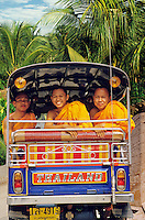 Three young Buddhist monks share a tuktuk. Bangkok. Thailand