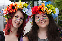 Two girls wearing rainbow colored flower headpieces, Seattle PrideFest 2015, Pride Festival, Washington, USA.