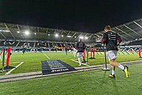 Tom Carroll of Swansea City exits the tunnel for the warm-up session during the Sky Bet Championship match between Swansea City and Blackburn Rovers at the Liberty Stadium, Swansea, Wales, UK. Tuesday 23 October 2018