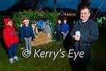 Fr Francis Nolan blesses the Crib in Spa on Saturday evening. Fr Francis Nolan (front). Back l to r: Gareth Lovett, Mia Falvey, Rian Murphy and Luke Falvey at the blessing of the crib on Saturday.