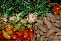 Farmers market diplay of raw vegetables including Potatoes, tomatoes, turnipfs, peppers, greens