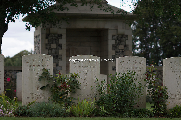 Gravestones of Chinese labourers died during World War I stand at Ayette Indian and Chinese Cemetery in Ayette, La Somme, France, August 18, 2014. 2014 marks 100th anniversary of the Great War.