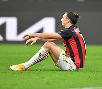 18th March 2021; San Siro stadium, Milan, Italy;  AC Milans Zlatan Ibrahimovic sits dejected during the Europa League round of 16 second leg match between AC Milan and Manchester United in Milan, Italy