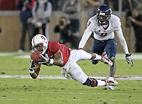 STANFORD, CA - November 6, 2010: Chris Owusu makes a 33 yard diving reception from Andrew Luck during a 42-17 Stanford win over the University of Arizona, in Stanford, California.