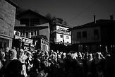 Women are watching the celebration of the wedding ceremony in the village of Ribnovo, some 200 km from Sofia, Bulgaria.