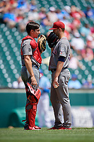 Lehigh Valley IronPigs catcher Matt McBride (30) talks with starting pitcher Cole Irvin (33) during an International League game against the Buffalo Bisons on June 9, 2019 at Sahlen Field in Buffalo, New York.  Lehigh Valley defeated Buffalo 7-6 in 11 innings.  (Mike Janes/Four Seam Images)