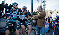 With farmers protests along the course, the race itself is delayed by 15 minutes, so riders take a break before the start is given. Like Guillaume Van Keirsbulck (BEL/Ettix-Quickstep) & Nikolas Maes (BEL/Ettix-QuickStep) chatting with minister of sports Philippe Muyters<br /> <br /> 99th Ronde van Vlaanderen 2015