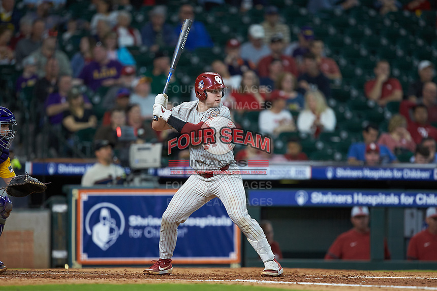 Justin Mitchell (14) of the Oklahoma Sooners at bat against the LSU Tigers in game seven of the 2020 Shriners Hospitals for Children College Classic at Minute Maid Park on March 1, 2020 in Houston, Texas. The Sooners defeated the Tigers 1-0. (Brian Westerholt/Four Seam Images)