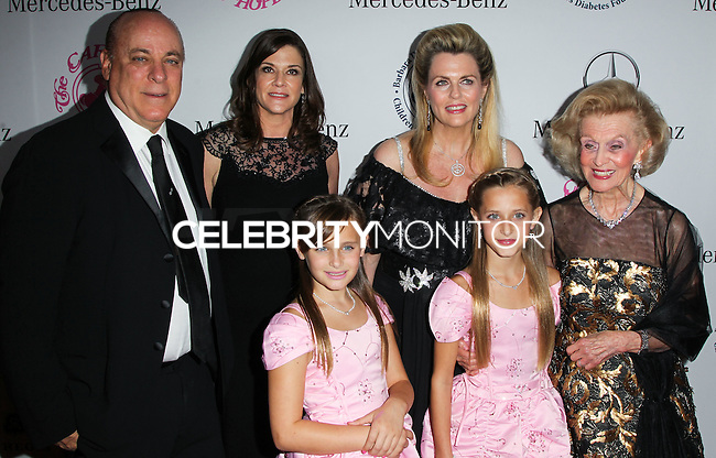BEVERLY HILLS, CA, USA - OCTOBER 11: Ariana Rickel, Isabella Rickel, Kenneth Rickel, Dana Davis, Nancy Davis, Barbara Davis arrive at the 2014 Carousel Of Hope Ball held at the Beverly Hilton Hotel on October 11, 2014 in Beverly Hills, California, United States. (Photo by Celebrity Monitor)