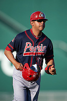 Peoria Chiefs hitting coach Jobel Jimenez (11) during a game against the Lansing Lugnuts on June 6, 2015 at Cooley Law School Stadium in Lansing, Michigan.  Lansing defeated Peoria 6-2.  (Mike Janes/Four Seam Images)