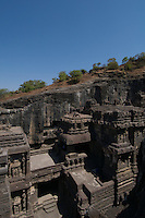 Kailash Temple at Ellora Caves Aurangabad, India.Kailash Temple, also Kailasa Temple is one of the 34 monasteries and temples, extending over more than 2km, that were dug side by side in the wall of a high basalt cliff in the complex located at Ellora, Maharashtra, India. Of these 34 monasteries and temples, the Kailasa (cave 16) is a remarkable example of Indian rock-cut architecture on account of its striking proportion; elaborate workmanship architectural content and sculptural ornamentation.. It is designed to recall Mount Kailash, the abode of Lord Shiva[2]. While it exhibits typical Dravidian features, it was carved out of one single rock. It was built in the 8th century by the Rashtrakuta king Krishna I..The Kailash Temple is notable for its vertical excavation-carvers started at the top of the original rock, and excavated downward, exhuming the temple out of the existing rock. The traditional methods were rigidly followed by the master architect which could not have been achieved by excavating from the front. The architects found to design this temple were from the southern Pallava kingdom.. Cave10 in AjantaCavescontains theoldest Indian paintingsof historical period, made around the 1st century BC.<br /> <br /> ThecavesatAjantadate from the 2nd century B.C.E. to 650 C.E andwerecut into the mountainside in two distinct phases. Discovered by chance in 1819 by British soldiers on a hunt, theAjanta Caveshave become an icon of ancient Indian art, and have influenced subsequent artists and styles.<br /> <br /> Thesepaintingsbeautifully depict various events in the life of Lord Buddha. All the caves are divided into two categories namely the Chaityas or the shrines and the Viharas or the monasteries. Chaityas were used to worship Lord Buddha while the Viharas were used by the Buddhist monks for their meditation