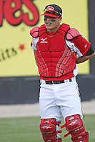 Devin Mesoraco #36 of the Carolina Mudcats putting on his catcher's gear before a game against the West Tenn Diamond Jaxx on May 30, 2010 in Zebulon, NC.