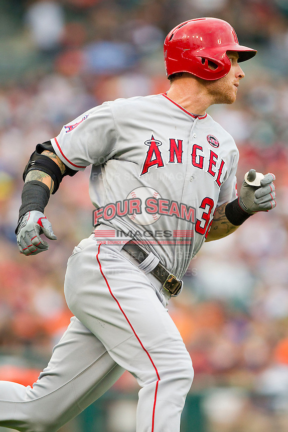Josh Hamilton (32) of the Los Angeles Angels hustles down the first base line against the Detroit Tigers at Comerica Park on June 25, 2013 in Detroit, Michigan.  The Angels defeated the Tigers 14-8.  (Brian Westerholt/Four Seam Images)