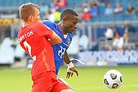 KANSAS CITY, KS - JULY 15: Alistair Johnson #2 of Canada ,Alex Christian #22 of Haiti during a game between Canada and Haiti at Children's Mercy Park on July 15, 2021 in Kansas City, Kansas.