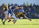 Podge Collins of Cratloe in action against Jack Browne of  Ballyea during the county senior hurling final at Cusack Park. Photograph by John Kelly.