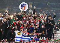 16th May 2018, Stade de Lyon, Lyon, France; Europa League football final, Marseille versus Atletico Madrid; Gabi of Atletico Madrid lifts the Europa League Trophy with his team and Atletico Madrid manager Diego Simeone as Atletico Madrid defeat Marseille 3-0