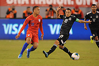 EAST RUTHERFORD, NJ - SEPTEMBER 7: Sergino Dest #18 of the United States battles for the ball with Andres Guardado #18 of Mexico during a game between Mexico and USMNT at MetLife Stadium on September 6, 2019 in East Rutherford, New Jersey.