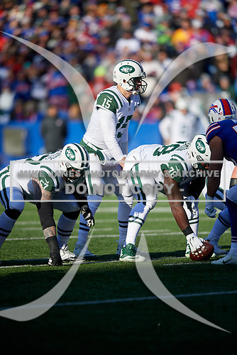 New York Jets quarterback Josh McCown (15) under center Jonotthan Harrison (78) during an NFL football game against the Buffalo Bills, Sunday, December 9, 2018, in Orchard Park, N.Y.  (Mike Janes Photography)