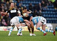 Photo: Richard Lane/Richard Lane Photography. London Wasps v Worcester Warriors. 01/01/2012. Wasps' Riki Flutey is tackled.