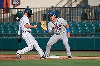 St. Lucie Mets first baseman Jeremy Vasquez (16) waits for a pickoff attempt throw as Luke Burch (7) gets back to the bag during a Florida State League game against the Lakeland Flying Tigers on April 24, 2019 at Publix Field at Joker Marchant Stadium in Lakeland, Florida.  Lakeland defeated St. Lucie 10-4.  (Mike Janes/Four Seam Images)