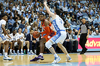 CHAPEL HILL, NC - JANUARY 11: Clyde Trapp #0 of Clemson University is defended by Andrew Platek #3 of the University of North Carolina during a game between Clemson and North Carolina at Dean E. Smith Center on January 11, 2020 in Chapel Hill, North Carolina.