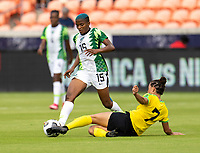 HOUSTON, TX - JUNE 10: Rasheedat Ajibade #15 of Nigeria is tackled by Chinyelu Asher #7 of Jamaica during a game between Nigeria and Jamaica at BBVA Stadium on June 10, 2021 in Houston, Texas.