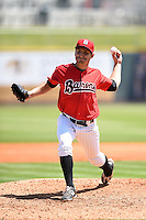 Birmingham Barons pitcher Evan Crawford (41) delivers a pitch during a game against the Tennessee Smokies on April 21, 2014 at Regions Field in Birmingham, Alabama.  Tennessee defeated Birmingham 10-5.  (Mike Janes/Four Seam Images)