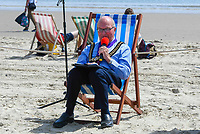 BNPS.co.uk (01202 558833)<br /> Pic: Graham Hunt/BNPS<br /> <br /> Town hall officials swapped their stuffy chambers for the sand and sea today as they took part in what is thought to be the UK's first ever council meeting on a beach.<br /> <br /> Weymouth Town Council in Dorset held the event on the beach in protest at the Government banning virtual meetings.<br /> <br /> Since May 6, votes cast at virtual council meetings have not been legally binding following a controversial ruling upheld by a High Court judge.<br /> <br /> But because social distancing is difficult to practice in many town halls, officials in Weymouth used a loophole in the rules to meet on a beach.