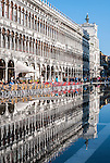 Reflection of the building and cafes in Piazza San Marco (St Mark's Square) Venice, Italy