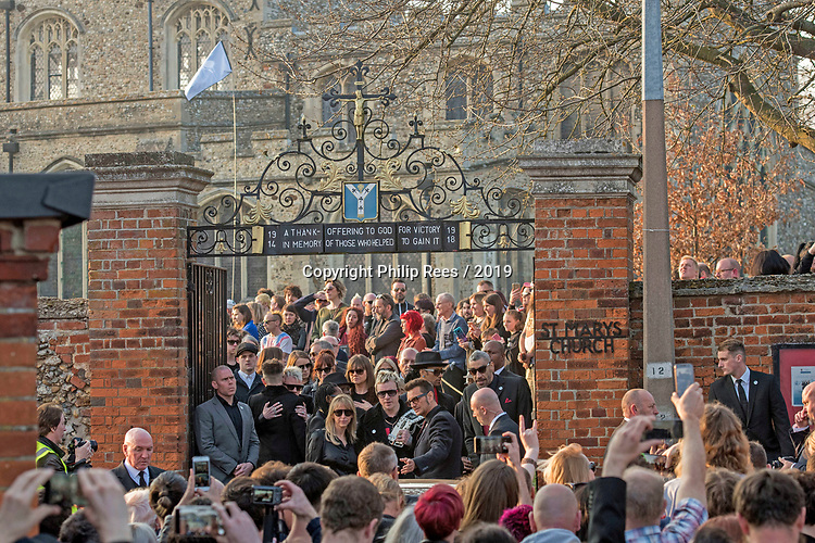 The  funeral of Prodigy singer Keith Flint at St Marys Church in Bocking,  Essex today. Mourners leave the service and band members Liam Howlett, Maxim (Keith Palmer) and Leeroy Thornhill can be seen leaving the front gates of the church.