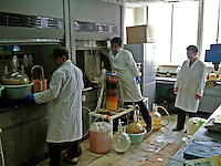 Workers are seen preparing a drug similar to MDPV at a laboratory belonging to CEC Limited, a company which exports the legal high to Great Britain, Pudong, Shanghai, China, 08 April 2010.
