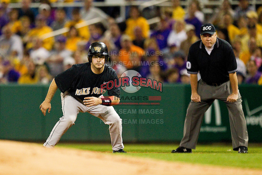 Pat Blair #11 of the Wake Forest Demon Deacons takes his lead off of first base against the LSU Tigers at Alex Box Stadium on February 18, 2011 in Baton Rouge, Louisiana.  The Tigers defeated the Demon Deacons 15-4.  Photo by Brian Westerholt / Four Seam Images