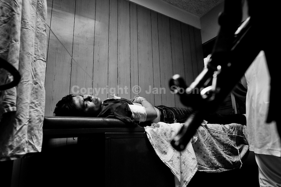 A young man fights for his life after being stabbed in the chest with a knife by a gang member in San Salvador, El Salvador, 12 May 2011. During the last two decades, Central America has become the deadliest region in the world that is not at war. According to the UN statistics, more people per capita were killed in El Salvador than in Iraq, in recent years. Due to the criminal activities of Mara Salvatrucha (MS-13) and 18th Street Gang (M-18), the two major street gangs in El Salvador, the country has fallen into the spiral of fear, violence and death. Thousands of Mara gang members, both on the streets or in the overcrowded prisons, organize and run extortions, distribution of drugs and kidnappings. Tattooed armed young men, mainly from the poorest neighborhoods, fight unmerciful turf battles with their coevals from the rival gang, balancing between life and death every day. Twenty years after the devastating civil war, a social war has paralyzed the nation of El Salvador.
