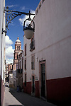 A narrow street leading to the cathedral in the city of Zacatecas, Mexico. The historic centre of Zacatecas is a UNESCO World Heritage site.