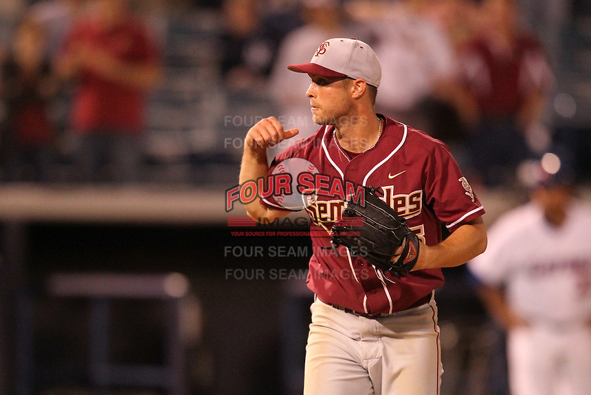 """Florida State Seminoles Mike McGee #25 during a game vs. the Florida Gators in the """"Florida Four"""" at George M. Steinbrenner Field in Tampa, Florida;  March 1, 2011.  Florida State defeated Florida 5-3.  Photo By Mike Janes/Four Seam Images"""