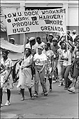 Dock workers with a trade union banner march through St.Georges to mark the third anniversary of the 1979 New Jewel Movement revolution.