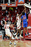 Florida guard Tyree Appleby (22) takes a shot Tuesday, Feb. 16, 2021, as Arkansas guard Davonte Davis (4) defends during the first half of play in Bud Walton Arena. Visit nwaonline.com/210217Daily/ for today's photo gallery. <br /> (NWA Democrat-Gazette/Andy Shupe)