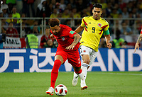 MOSCU - RUSIA, 03-07-2018: Radamel FALCAO GARCIA (Der) jugador de Colombia disputa el balón con Kyle WALKER (Izq) jugador de Inglaterra durante partido de octavos de final por la Copa Mundial de la FIFA Rusia 2018 jugado en el estadio del Spartak en Moscú, Rusia. / Radamel FALCAO GARCIA (R) player of Colombia fights the ball with Kyle WALKER (L) player of England during match of the round of 16 for the FIFA World Cup Russia 2018 played at Spartak stadium in Moscow, Russia. Photo: VizzorImage / Julian Medina / Cont