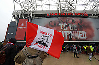 """Pictured: A man holding a """"Thank you sir Alex"""" flag outside the ground before kick off. Sunday 12 May 2013<br /> Re: Barclay's Premier League, Manchester City FC v Swansea City FC at the Old Trafford Stadium, Manchester."""