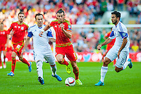 Gareth Bale of Wales ( Centre with ball ) makes a run through the Isreal defence  during their UEFA EURO 2016 Group B qualifying round match held at Cardiff City Stadium, Cardiff, Wales, 06 September 2015. EPA/DIMITRIS LEGAKIS