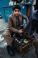 December 1978, Istanbul, Turkey --- Young boy self employed as shoe shine in Istanbul. - Child labor as seen around the world between 1979 and 1980 - Photographer Jean Pierre Laffont, touched by the suffering of child workers, chronicled their plight in 12 countries over the course of one year.  Laffont was awarded The World Press Award and Madeline Ross Award among many others for his work.