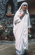"""Calcutta, India. April 04, 1975.<br /> Mother Teresa inside her Kalighat Home for the Dying in Calcutta. The first Home for the Dying opened in 1952 and was a free hospice for the poor. Mother Teresa (Agnes Gonxha Boyaxihu) the Roman Catholic, Albanian nun revered as India's """"Saint of the Slums,"""" was awarded the 1979 Nobel Peace Prize."""