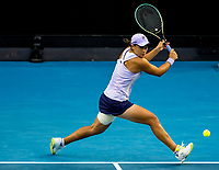 13th February 2021, Melbourne, Victoria, Australia; Ashleigh Barty of Australia returns the ball during round 3 of the 2021 Australian Open on February 13 2020, at Melbourne Park in Melbourne, Australia.