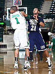 Jackson State Tigers guard Phillip Williams (21) takes a shot over North Texas Mean Green guard Dominique Johnson (1)  in the game between the Jackson State Tigers and the University of North Texas Mean Green at the North Texas Coliseum,the Super Pit, in Denton, Texas. UNT defeated Jackson 68 to 49