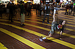 B-Boy Lilou performing on the streets of Hong Kong's Causeway Bay district.