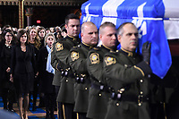 Widow Chantal Renaud (second left) and her daughter Pascale (left) walk behind the casket of former Quebec premier Bernard Landry as it's carried into Notre-Dame Basilica for his funeral service in Montreal on Tuesday, November 13, 2018. THE CANADIAN PRESS/Paul Chiasson